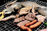 Lunch of charcoal-grilled meat and seafood